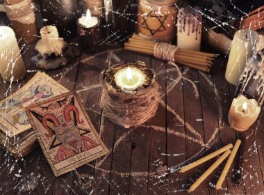 Candles and deck of tarot cards
