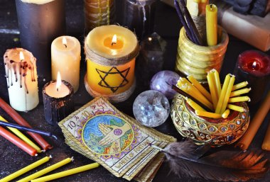 Magic objects, candles and tarot cards