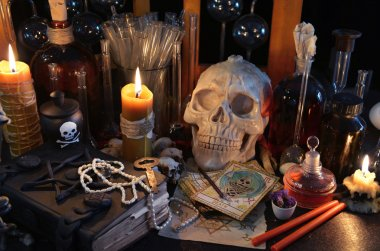 Books with skull and tarot cards