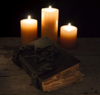 Magic book with three candles