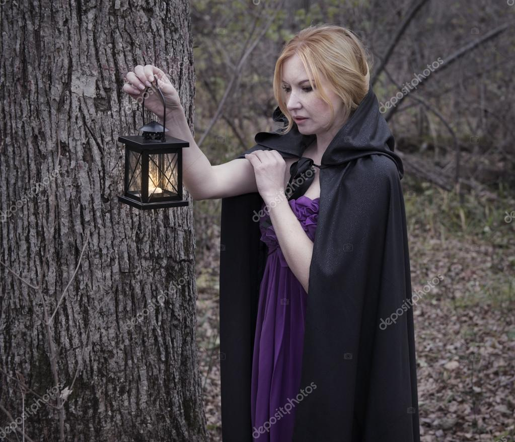 Beautiful blonde girl with lantern