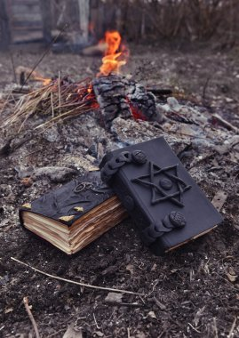black magic books with pentacle