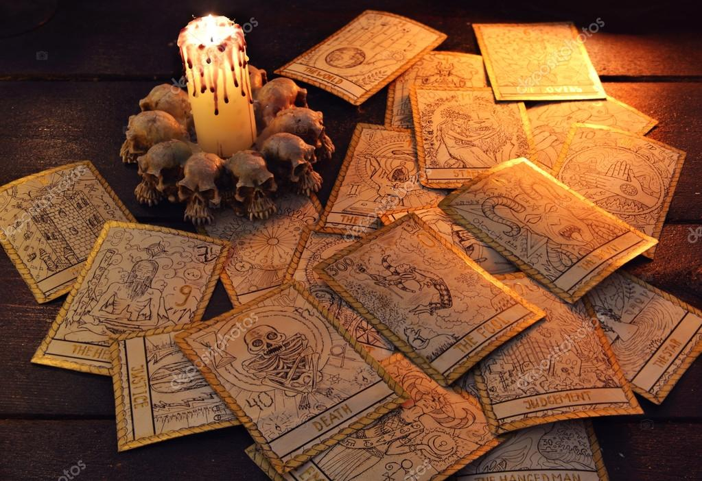 Tarot cards with candle — Stock Photo © Samiramay #99969100