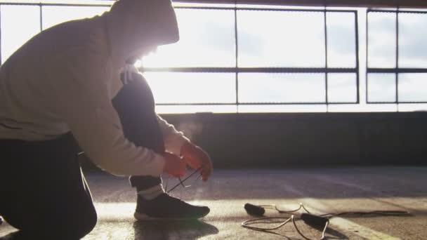 Athlete tying shoe laces