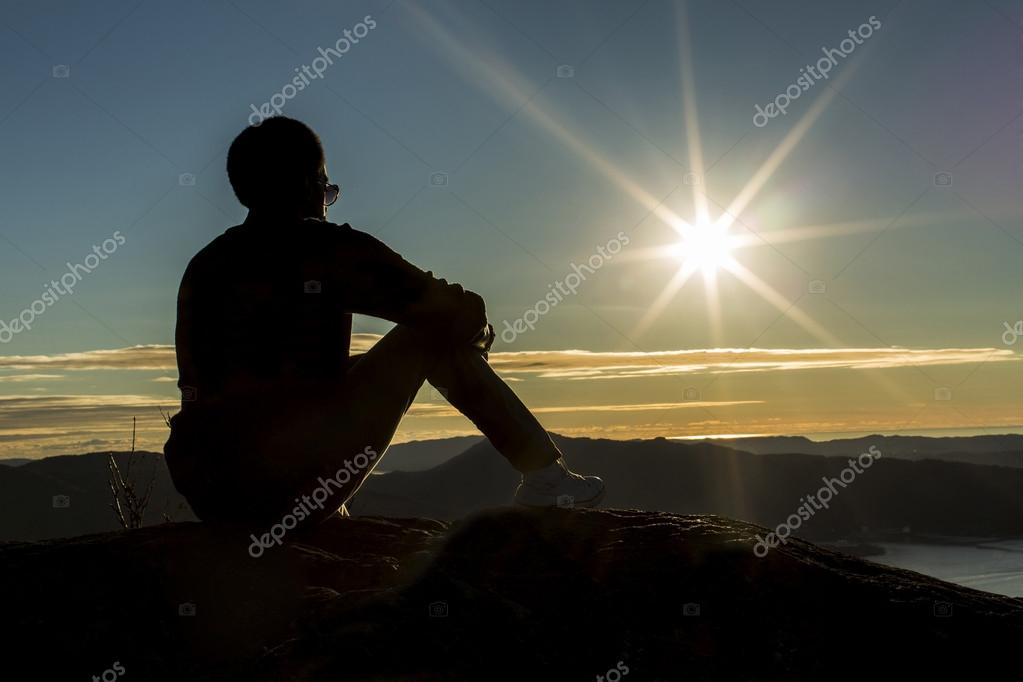 Silhouette man on a mountain top