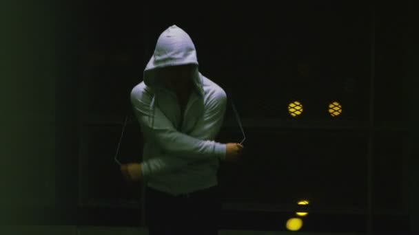 Hooded athlete skipping
