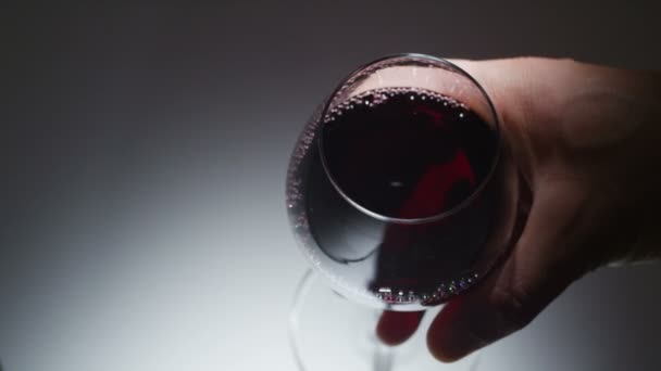 Glass of red wine being consumed in slow motion