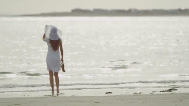 Young beautiful woman on ocean beach