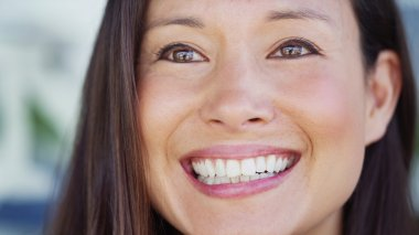 Close up portrait of an attractive young woman smiling slightly off camera