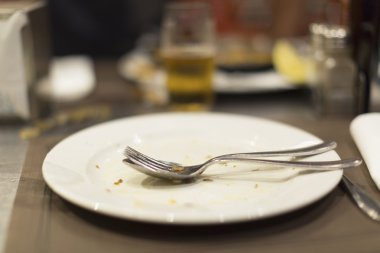 Empty plate of food after meal on a table