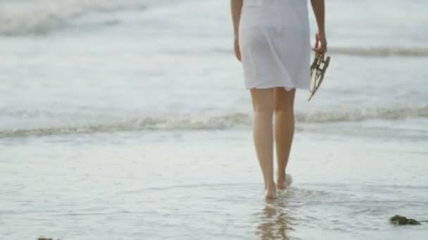 woman walking along the beach shore