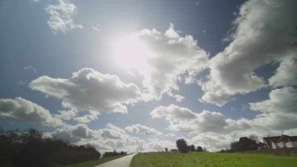 Camera reveals a country road on a sunny day