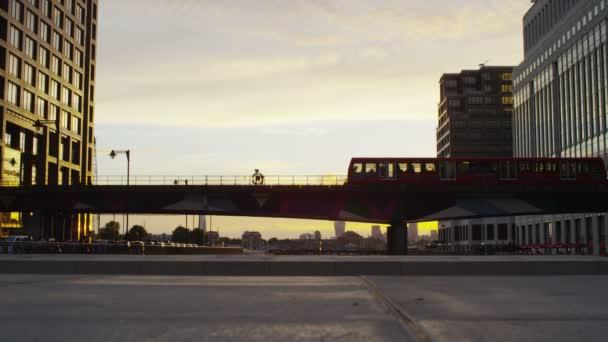 train going across a bridge at Canary Wharf in London