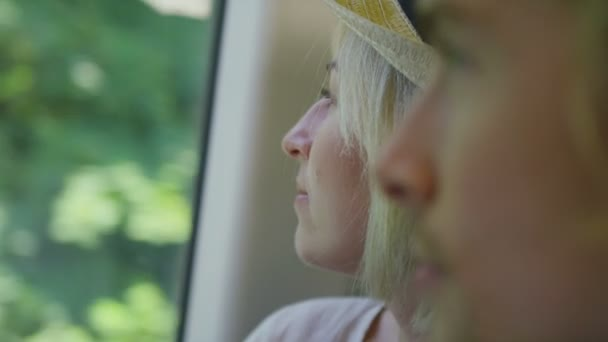 woman on a train with her partner looks out of the window