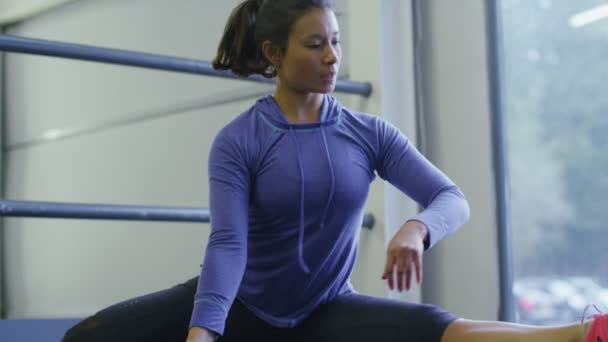 female stretches on an exercise floor