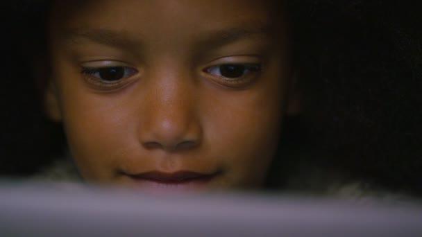 girl eyes watching something on a digital tablet