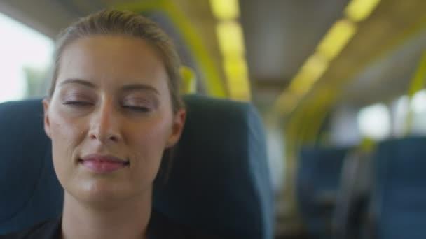 woman relaxing on a train and closing her eyes
