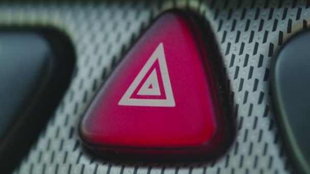 blinking hazard light on the dashboard of a car