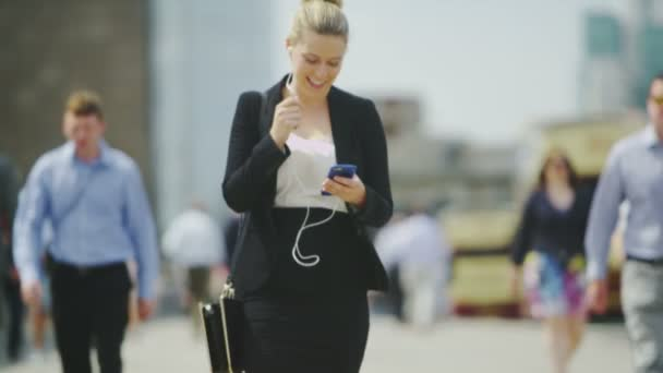 business woman walking and talking on her smart phone