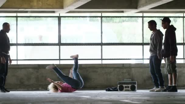 Flexible breakdancer showing off her moves