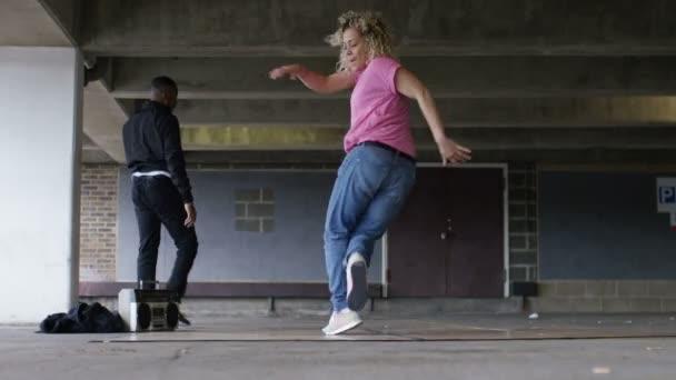 Female breakdancer twirls in her dancing