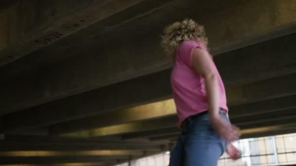 Female breakdancer on the floor