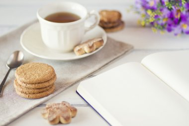 Blank Notebook With tea and cookies