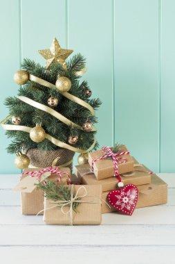Some christmas gift boxes around the christmas tree