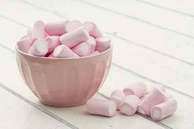 Pink and white marshmallow in a bowl