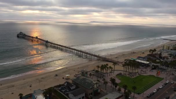 Imperial Beach boardwalk with pier, drone view