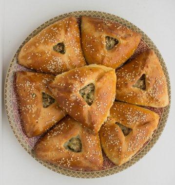 Echpochmak - meat pies, potatoes and greens. Tatar dish