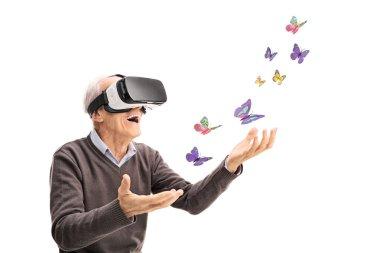 Senior visualizing butterflies via VR headset