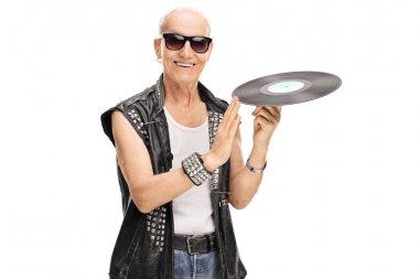 Senior punk rocker spinning a vinyl