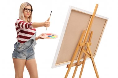 Blond female artist measuring proportions on a painting with a paintbrush isolated on white background stock vector