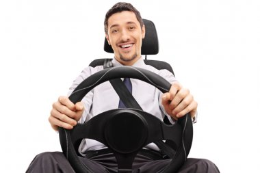 Cheerful guy holding a steering wheel