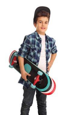 Skater boy posing with a skateboard