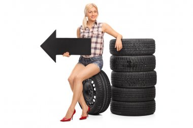 Female mechanic holding an arrow