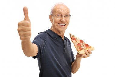 Elderly man eating a slice of pizza