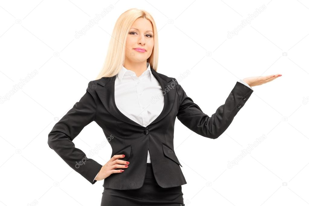 Blond Businesswoman Gesturing With Hand Stock Photo