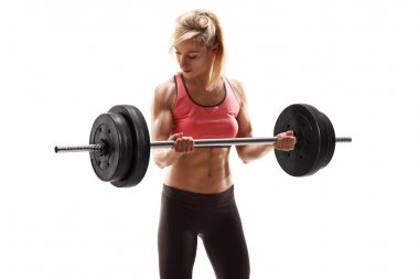 Muscular woman exercising with barbell