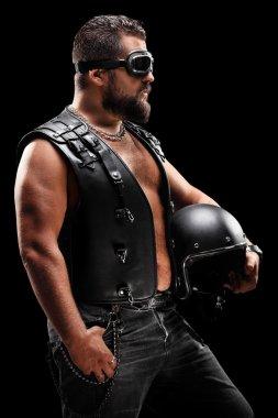 Male biker holding helmet