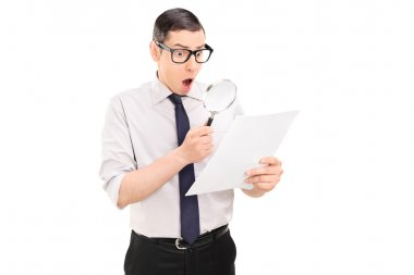 Man looking at document through magnifier