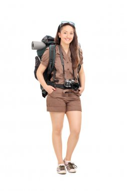 Female traveler with hiking equipment