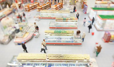 People shopping in large supermarket