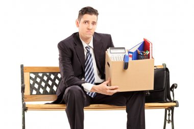 Fired businessman holding box with stuff