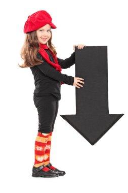 Little girl holding an arrow
