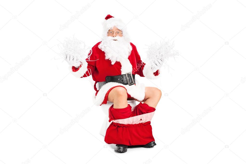 Santa holding bunch of shredded paper