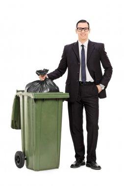 Businessman taking out trash