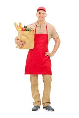 Market vendor with groceries bag