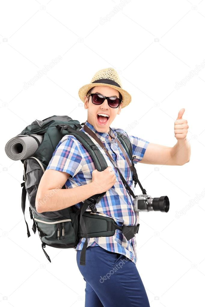 Male tourist giving thumb up